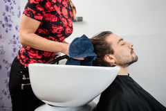 Hairdresser Wiping Male Customer's Hair In Salon Stock Photography