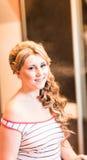 Hairdresser woman curls her hair Stock Photos