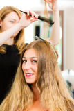 At the hairdresser - woman gets new hair colour Stock Photo