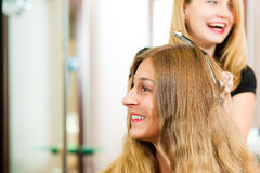 At the hairdresser - woman gets new hair colour Stock Photos