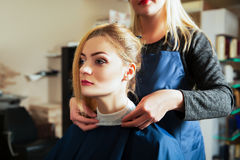 Hairdresser with woman in hairdressing salon. Stock Photos