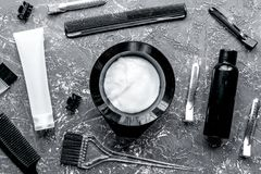 Hairdresser woorking desk with tools on gray background top view. Hairdresser working desk with tools for dye hair on gray table background top view royalty free stock photography