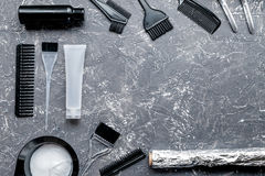 Hairdresser woorking desk with tools on gray background top view mock up. Hairdresser working desk with tools for dye hair on gray table background top view mock stock image