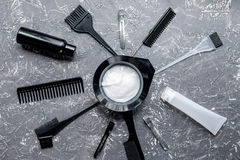 Hairdresser woorking desk with tools on gray background top view. Hairdresser working desk with tools for dye hair on gray table background top view stock photography