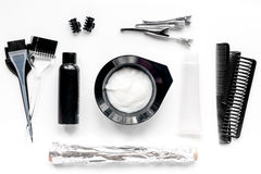 Hairdresser woorking desk with tools on white background top view. Hairdresser working desk with tools for dye hair on white table background top view royalty free stock images