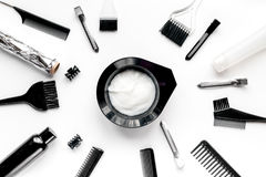 Hairdresser woorking desk with tools on white background top view. Hairdresser working desk with tools for dye hair on white table background top view stock photography