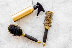 Hairdresser work with combs and brushes for styling and dyeing on stone background top view Royalty Free Stock Photo