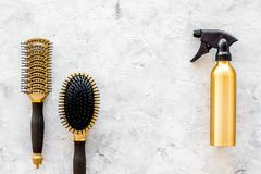 Hairdresser work with combs and brushes for styling and dyeing on stone background top view space for text Royalty Free Stock Images