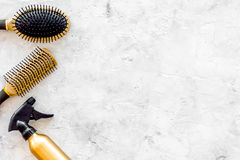 Hairdresser work with combs and brushes for styling and dyeing on stone background top view space for text Royalty Free Stock Photo