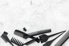 Hairdresser work desk with tools for hair styling on gray stone background top view space for text Stock Image