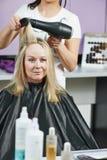 Hairdresser at work. Dryeing hair Royalty Free Stock Photos