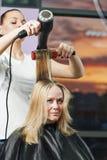 Hairdresser at work. Drying hair Royalty Free Stock Photos