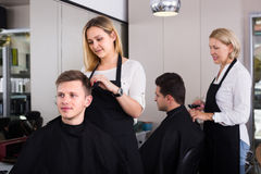 Hairdresser at the work Stock Photos