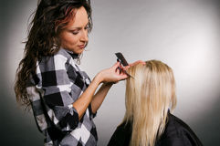 Hairdresser working with blonde Royalty Free Stock Image