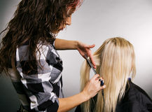 Hairdresser working with client Royalty Free Stock Photos