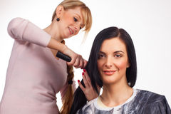 Hairdresser working with a client Stock Photos