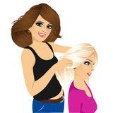 Hairdresser working cutting long hair Royalty Free Stock Photography