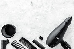 Hairdresser working desk with dryer and tools for hair styling on gray stone desk background top view mock up Royalty Free Stock Images