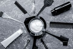 Hairdresser woorking desk with tools on gray background top view. Hairdresser working desk with tools for dye hair on gray table background top view stock image