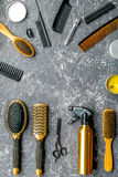 Hairdresser working desk with tools on gray background top view mock up Stock Photography