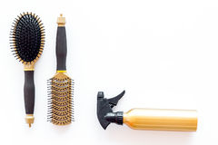Hairdresser working desk with tools for hair styling on white desk background top view mock up. Hairdresser working desk space with tools for hair styling on Royalty Free Stock Images