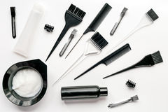 Hairdresser working desk with tools on white background top view. Hairdresser working desk with tools for dye hair on white table background top view royalty free stock image