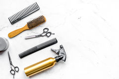 Hairdresser working desk with tools on white background top view mock up Stock Photos