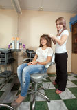 Hairdresser working with   girl Royalty Free Stock Photo