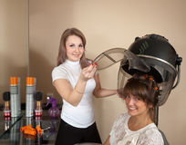 Hairdresser working with hair dryer Royalty Free Stock Photo