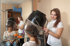 Hairdresser working with hair dryer Stock Image