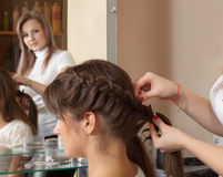 Hairdresser working with long-hair Royalty Free Stock Image