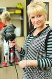 Hairdresser in workplace in beauty salon Stock Photos