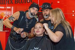 Hairdresser works with a model at the exhibition Stock Photo
