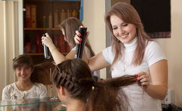 Hairdresser works on woman hair Stock Photography