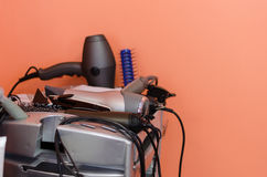 Hairdressers accessories lie neatly on shelf Stock Photography