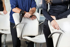Hairdressers With Dryer And Scissors Stock Photos