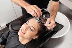 Hairdressers Hand Washing Customer's Hair Royalty Free Stock Image