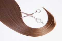 Hairdressers scissors and lock of hair Stock Photo