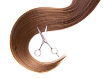 Hairdressers scissors and lock of hair Stock Photography