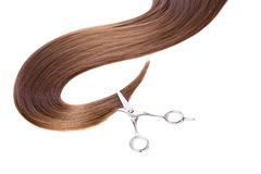 Hairdressers scissors and lock of hair Royalty Free Stock Photos