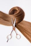Hairdressers scissors and lock of hair Stock Image