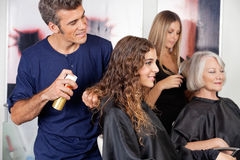Hairdressers Setting Up Client's Hair Stock Images