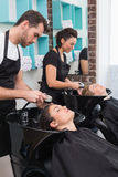 Hairdressers washing their clients hair Royalty Free Stock Photography
