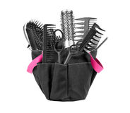 Hairdressing appliances and appliances for manicure in a bag on Royalty Free Stock Photography