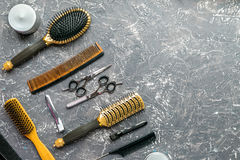 Hairdressing concept with barber tools on gray background top view mock up. Hairdressing concept with barber tools for styling on gray desk background top view royalty free stock images