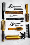 Hairdressing concept with barber tools on white background top v. Hairdressing concept with barber tools for styling on white desk background top view stock image