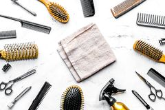 Hairdressing concept with barber tools on white background top v. Hairdressing concept with barber tools for styling on white desk background top view stock photos