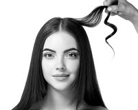 Hairdressing Process. Girl Model Hair Straightening Irons.Beautiful Woman With Long Straight Hair. Healthy Hair. Stock Photography