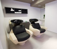 Hairdressing salon. Special sink and chair at hairdressing salon Royalty Free Stock Image