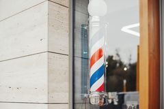Hairdressing Saloon Vintage Barber Pole In Barbershop Showcase. Royalty Free Stock Images